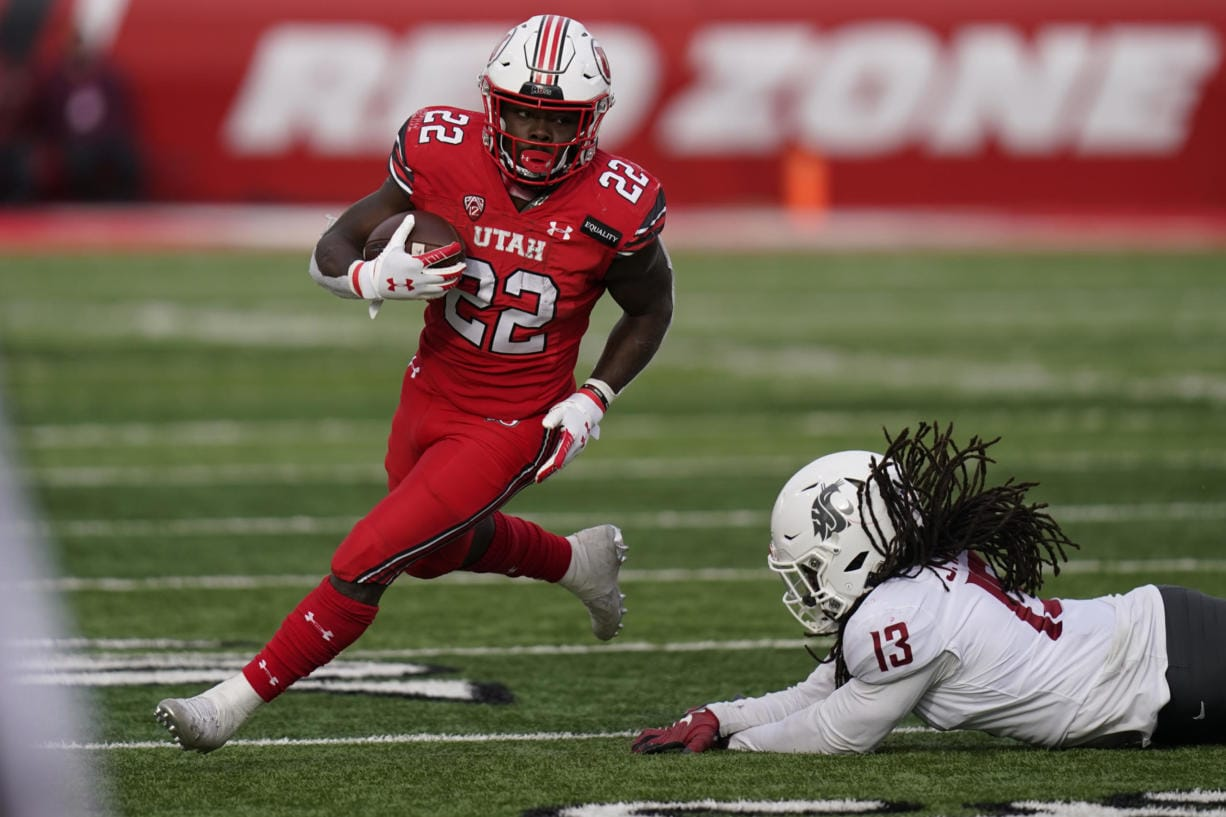 Utah running back Ty Jordan (22), a star freshman running back for the University of Utah who grew up in the Dallas area, has died, school officials announced Saturday, Dec. 26, 2020. Authorities in Texas and Utah have not released details about the circumstances of the Jordan's death. He finished the 2020 season by rushing for 154 yards and three touchdowns against Washington State on Dec. 19, 2020.