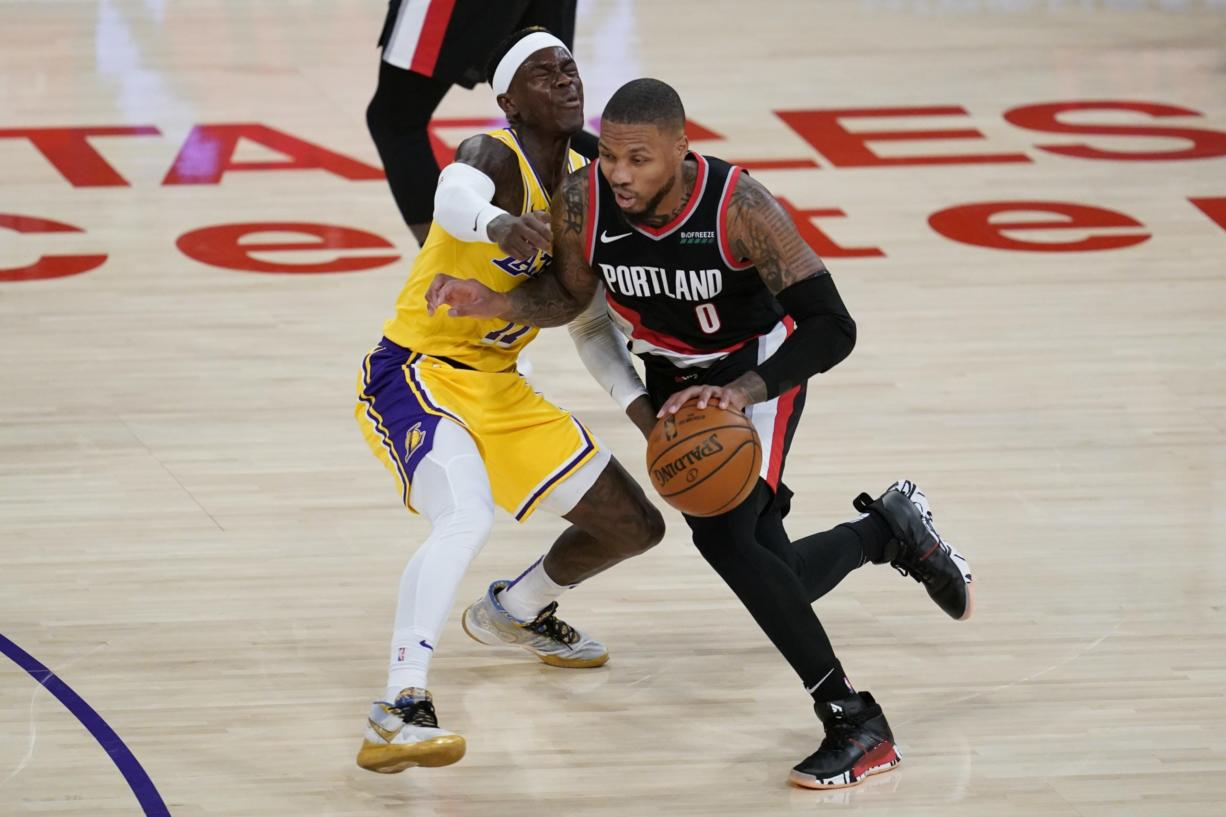Portland Trail Blazers guard Damian Lillard, right, fouls Los Angeles Lakers guard Dennis Schroeder (17) during the second quarter of an NBA basketball game Monday, Dec. 28, 2020, in Los Angeles.
