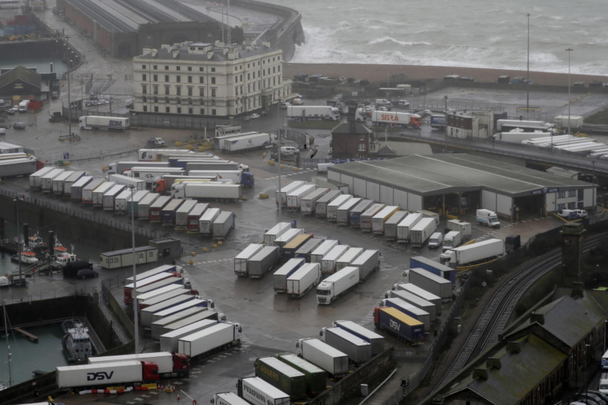 Lorries are parked near the port, Monday, Dec. 21, 2020, after the Port of Dover, England, was closed and access to the Eurotunnel terminal suspended following the French government's announcement. France banned all travel from the UK for 48 hours from midnight Sunday, including trucks carrying freight through the tunnel under the English Channel or from the port of Dover on England's south coast.