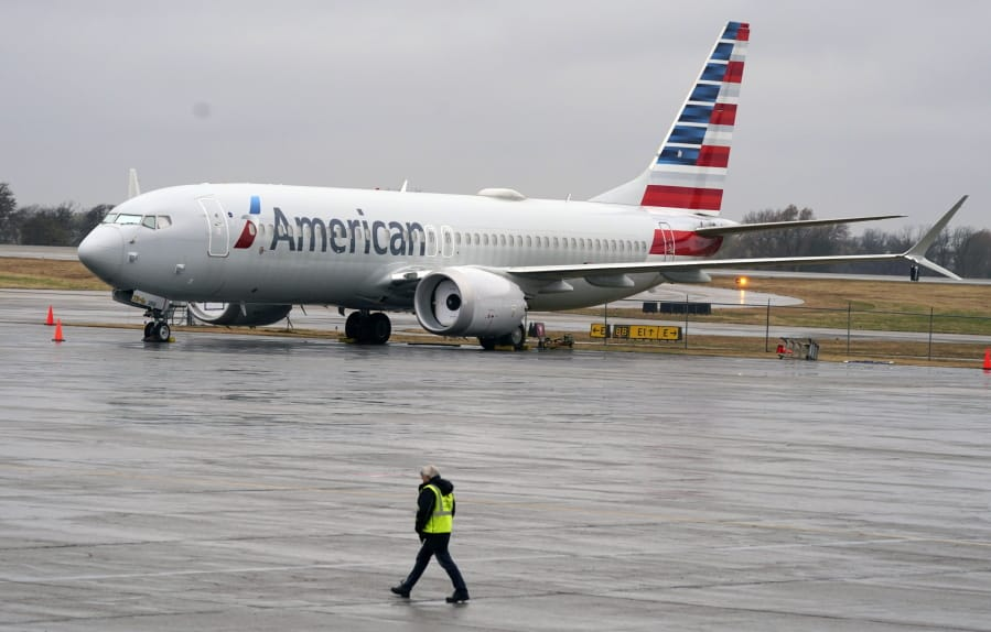 FILE - In this Dec. 2, 2020 file photo, an American Airlines Boeing 737 Max jet plane is parked at a maintenance facility in Tulsa, Okla.  Paying passengers were scheduled to board a Boeing 737 Max in Miami on Tuesday, Dec. 29 for the first time since safety regulators allowed the plane to fly again after two deadly crashes.