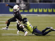 Seattle Seahawks strong safety Jamal Adams, right, gets to Arizona Cardinals quarterback Kyler Murray (1) just as Murray gets a pass off, during the second half of an NFL football game, Thursday, Nov. 19, 2020, in Seattle.