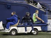Seattle Seahawks tight end Greg Olsen (88) is taken off the field on a cart after going down with an injury against the Arizona Cardinals during the second half of an NFL football game, Thursday, Nov. 19, 2020, in Seattle.