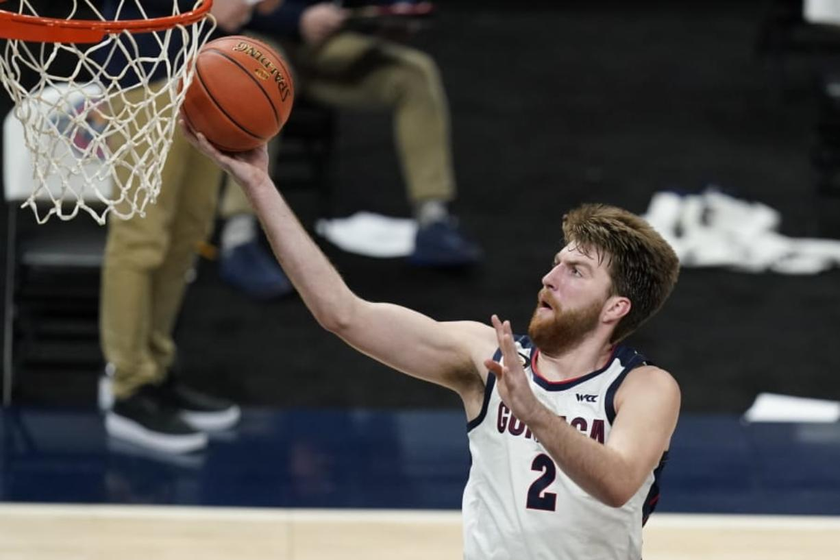 Gonzaga's Drew Timme goes to the basket against West Virginia in Indianapolis. It was the last game the Zags played and that was Dec. 2. Coach Mark Few of top-ranked Gonzaga says the suspension of basketball activities for the past two weeks because of the coronavirus pandemic has ''not helped us in any way, shape or form.?