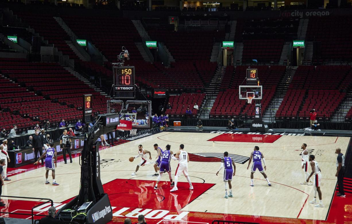 Portland Trail Blazers guard Gary Trent Jr. drives to the basket against the Sacramento Kings in an empty Moda Center during the first half of a preseason NBA basketball game in Portland, Ore., Friday, Dec. 11, 2020.
