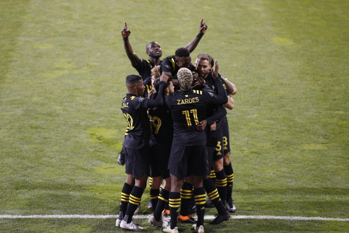 Columbus Crew players celebrate a goal against the Seattle Sounders during the first half of the MLS Championship soccer match Saturday, Dec. 12, 2020, in Columbus, Ohio.