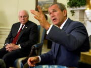 FILE - President George W. Bush, right, with Vice President Dick Cheney at his side, speaks during a meeting with congressional leaders in the White House Oval Office on Sept. 18, 2002. A new CNN Films documentary explores the role of the U.S. vice presidency, which in modern times has emerged into a more powerful position. Still, the film notes that  a veep's duties are all up to the president.