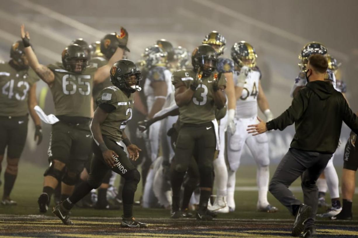 Army quarterback Tyhier Tyler celebrates after defeating Navy in an NCAA college football game Saturday, Dec. 12, 2020, in West Point, N.Y.