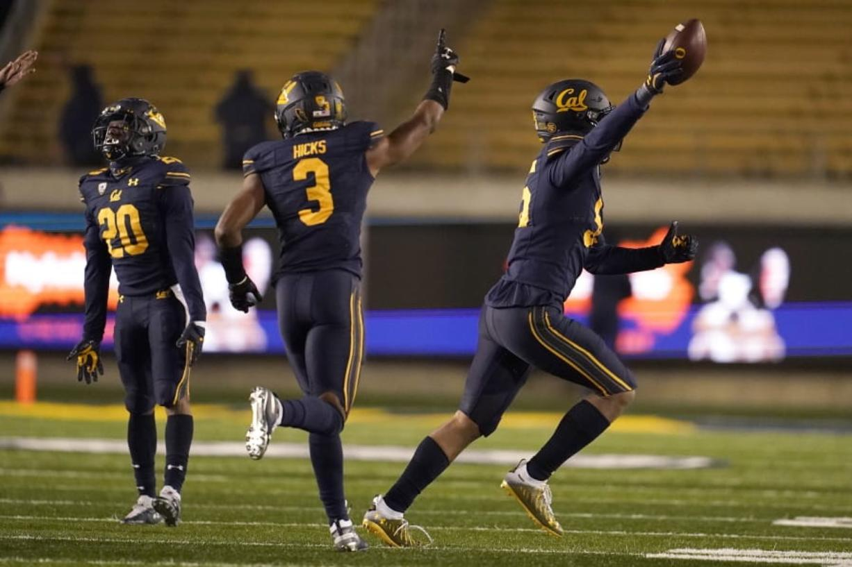 California linebacker Muelu Iosefa, right, celebrates with Josh Drayden (20) and Elijah Hicks (3) after recovering a fumble by Oregon wide receiver Johnny Johnson III during the second half of an NCAA college football game in Berkeley, Calif., Saturday, Dec. 5, 2020.