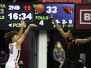 Washington State guard Isaac Bonton (10) shoots over Oregon State forward Maurice Calloo (1) during the second half of an NCAA college basketball game in Pullman, Wash., Wednesday, Dec. 2, 2020. Washington State won 59-55.