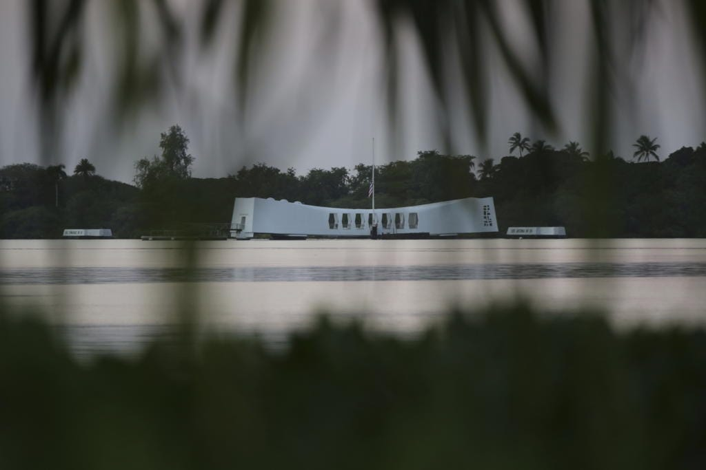 The USS Arizona Memorial is shown in Pearl Harbor on Monday, Dec. 7, 2020, in Pearl Harbor, Hawaii. Officials gathered in Pearl Harbor to remember those killed in the 1941 Japanese attack, but public health measures adopted because of the coronavirus pandemic meant no survivors were present. The military broadcast video of the ceremony live online for survivors and members of the public to watch from afar.