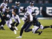 Seattle Seahawks' DK Metcalf, left, is tackled by Philadelphia Eagles' Darius Slay during the first half of an NFL football game, Monday, Nov. 30, 2020, in Philadelphia.