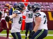Seattle Seahawks tight end Jacob Hollister (86) celebrating his touchdown with teammate Seattle Seahawks center Ethan Pocic (77) during the first half of an NFL football game against the Washington Football Team, Sunday, Dec. 20, 2020, in Landover, Md.