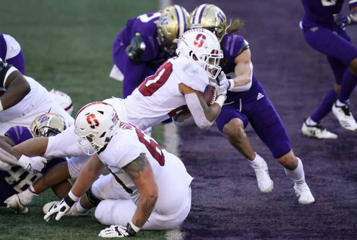 Stanford running back Austin Jones dives into the end zone on a touchdown run against Washington in the first half of an NCAA college football game Saturday, Dec. 5, 2020, in Seattle.