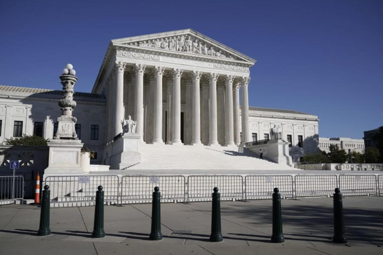 FILE - In this Nov. 4, 2020 photo, The Supreme Court in Washington. (AP Photo/J.