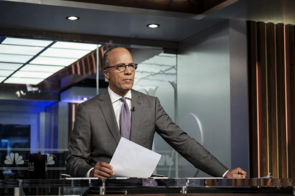 """NBC's Lester Holt appears on the set in New York on Tuesday Aug. 7, 2018. The """"NBC Nightly News"""" anchor occasionally ends his broadcasts now with commentaries, an unusual departure for network evening newscasts that have a lengthy track record of playing it straight. Holt's commentaries trend toward the non-controversial, with a central theme of trying to find common ground that will pull Americans together."""