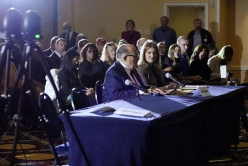 Rudy Giuliani, center, speaks Nov. 25 at a hearing of the Pennsylvania State Senate Majority Policy Committee in Gettysburg, Pa.