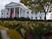 A ribbon hangs on the White House for World AIDS Day 2020, Tuesday, Dec. 1, 2020, in Washington.