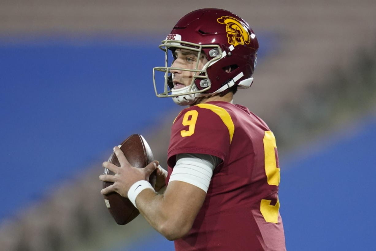 Southern California quarterback Kedon Slovis (9) looks for a receiver during the first quarter of an NCAA college football game against UCLA, Saturday, Dec 12, 2020, in Pasadena, Calif.