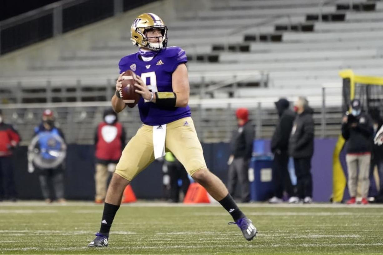 Washington quarterback Dylan Morris drops back to pass against Utah during the second half of an NCAA college football game Saturday, Nov. 28, 2020, in Seattle. (AP Photo/Ted S.
