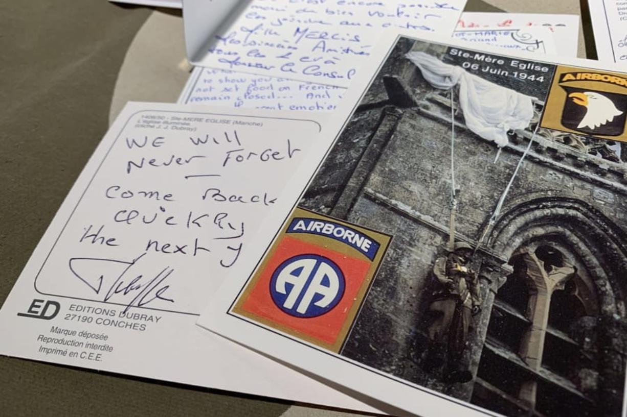 In this Tuesday, Dec. 15, 2020 photo, A handwritten post card from a resident of Sainte-Mere-Eglise, France thanks U.S. paratroopers for liberating their village from Nazi occupation, seen at Fort Bragg, N.C. The town sent 500 notes to Fort Bragg, North Carolina which were read by soldiers. 12,000 82nd paratroopers fought to liberate Normandy on June 6th, 1944. 1,400 were lost their lives in the invasion.