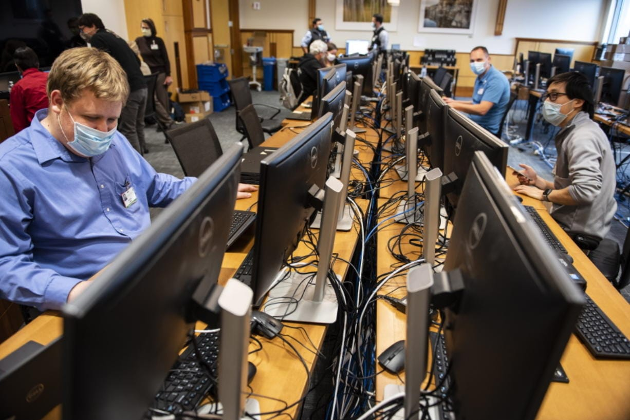 In this photo provided by the University of Vermont Health Network, IT staff at the University of Vermont Medical Center in Burlington, Vt., continue work to scan thousands of the hospital's computer systems for malware on Friday, Nov. 20, 2020, after the Oct. 28 cyberattack forced a shut down of the hospital's electronic medical records system and other key systems.