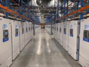 """This handout photo taken in Oct. 2020 and provided by Pfizer shows part of a """"freezer farm,"""" a football field-sized facility for storing finished COVID-19 vaccines, in Puurs, Belgium. Pfizer and BioNTech say they've won permission Wednesday, Dec. 2, 2020, for emergency use of their COVID-19 vaccine in Britain, the world's first coronavirus shot that's backed by rigorous science -- and a major step toward eventually ending the pandemic."""
