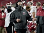 Washington State head coach Nick Rolovich walks the sideline during the second half of an NCAA college football game against Southern California in Los Angeles, Sunday, Dec. 6, 2020.