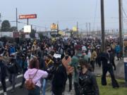 A few hundred protesters march down Highway 99 in Hazel Dell, the latest in a string of demonstrations since Kevin E. Peterson Jr. was fatally shot by police on Oct. 29.