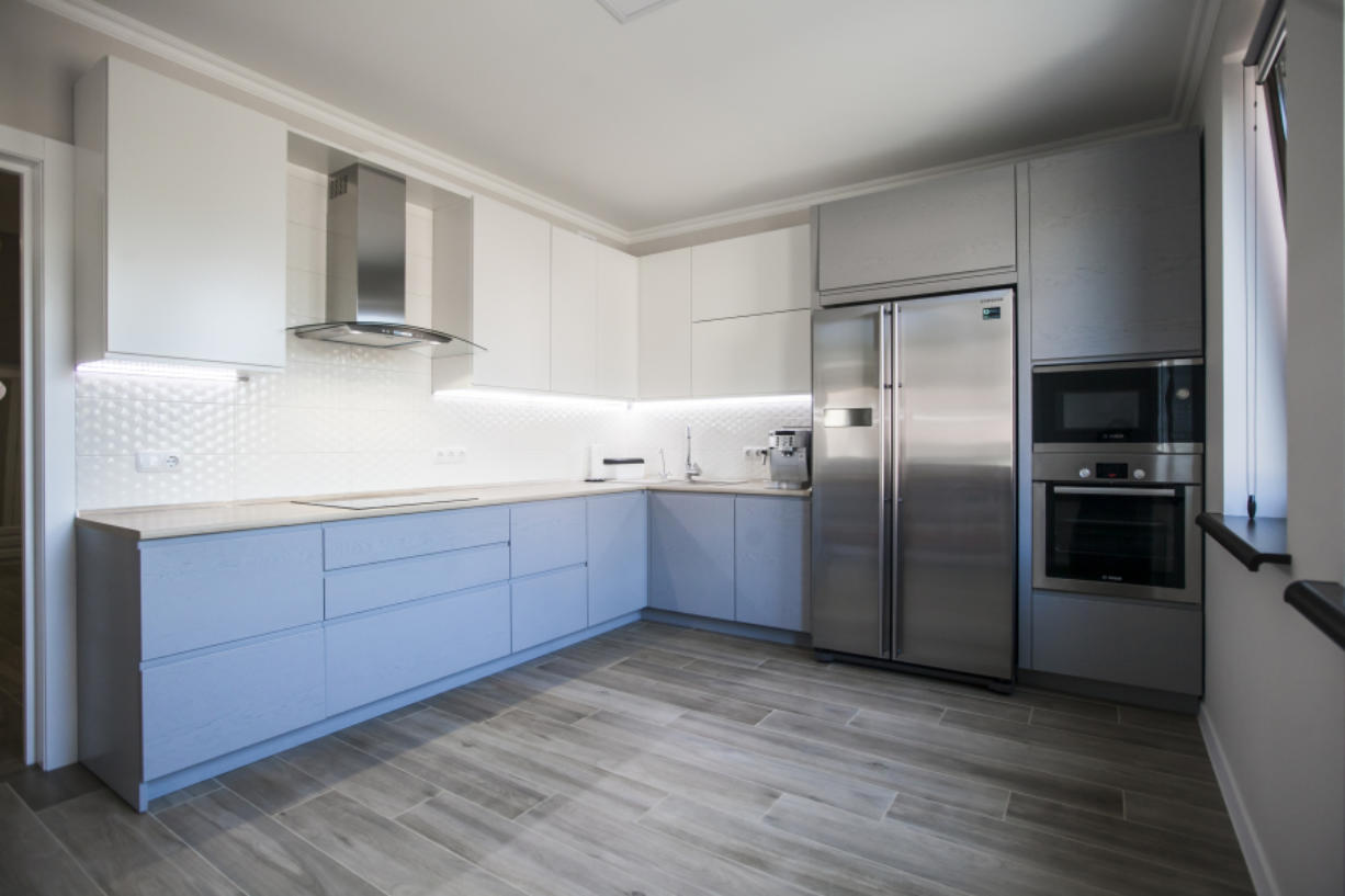 Repainting cabinets can update a kitchen without remodeling it.