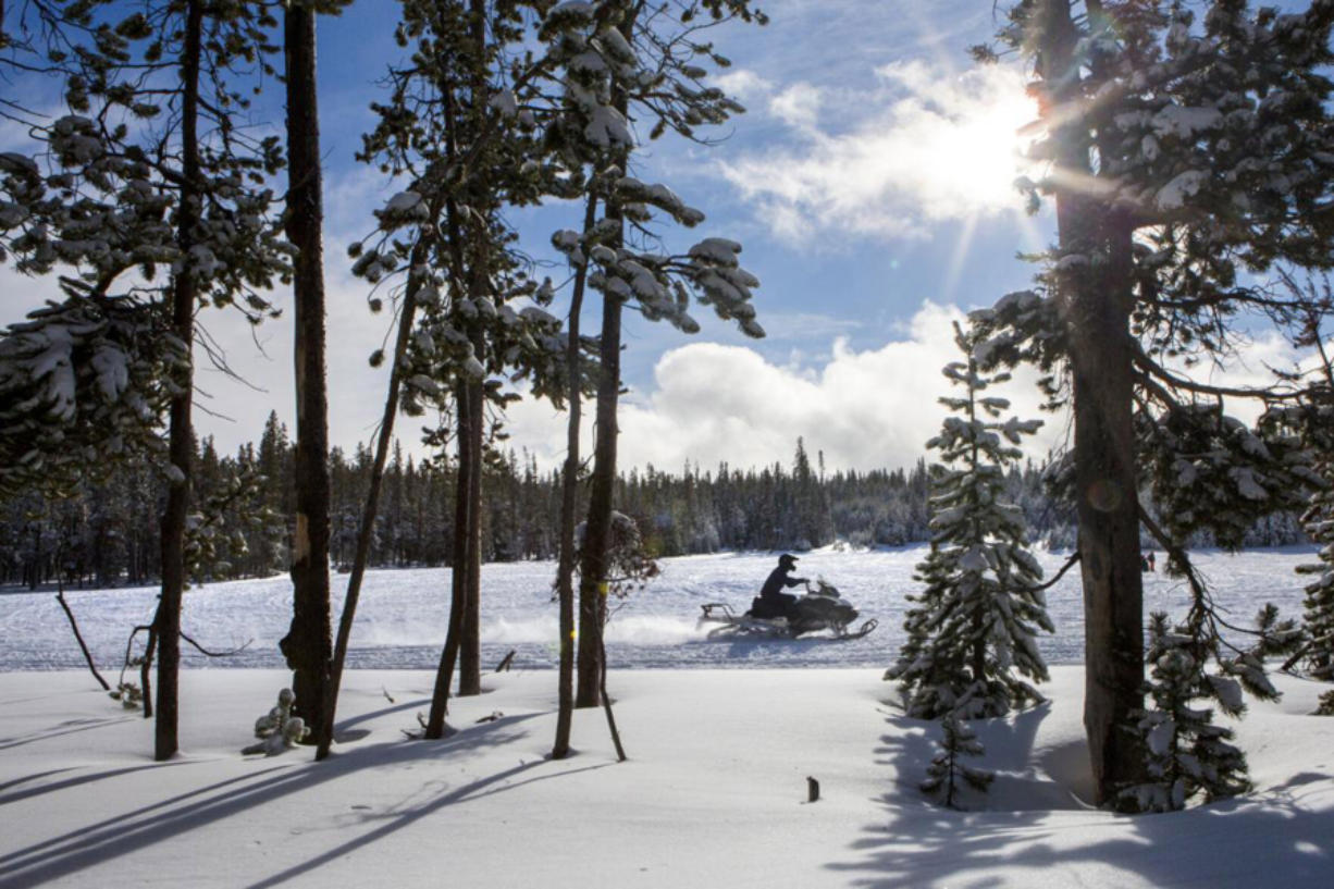 A snowmobiler rides around a clearing at Wanoga Sno-park in Bend. Ore.