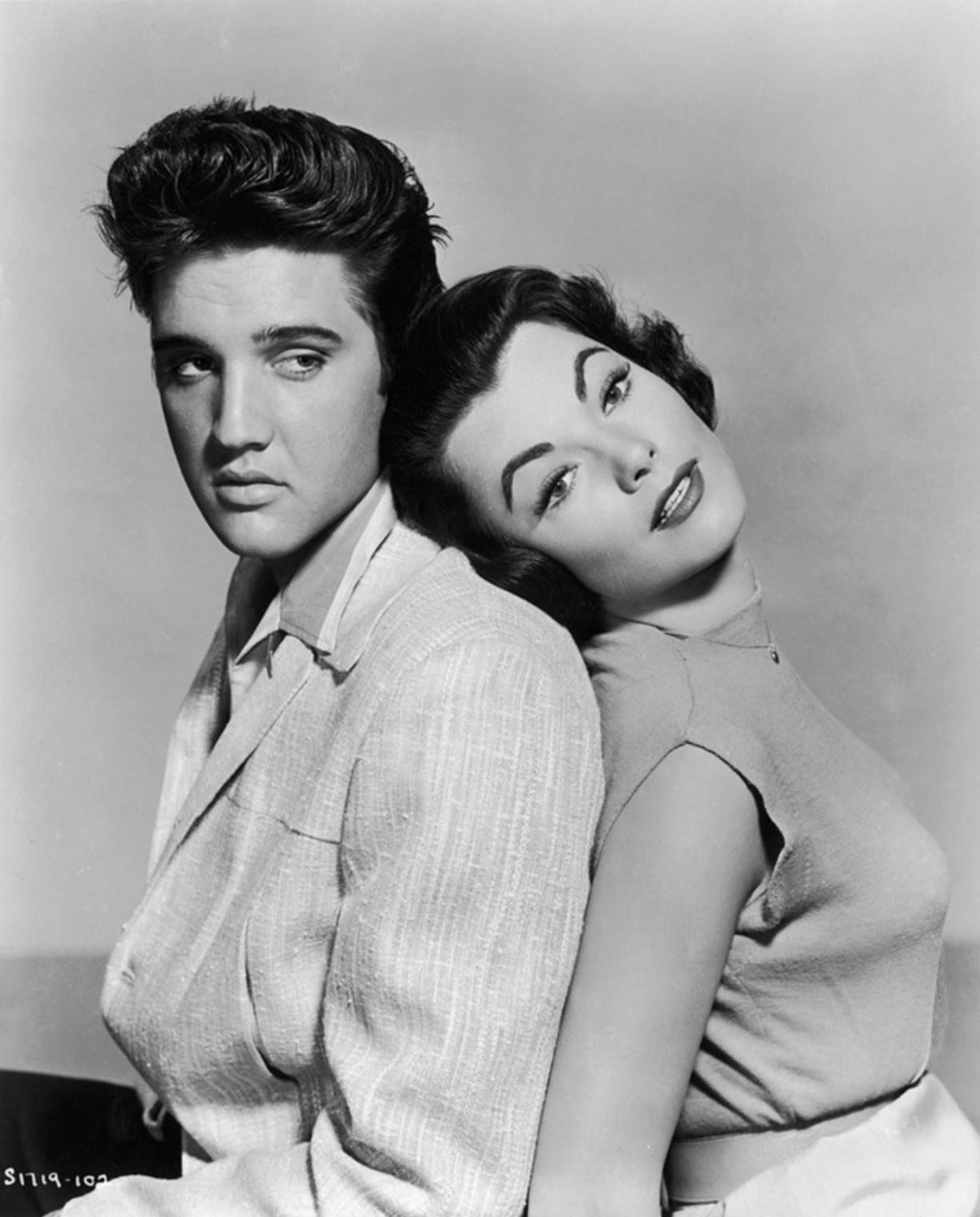 "Elvis Presley and Judy Tyler star in the musical film ""Jailhouse Rock"" in 1957."