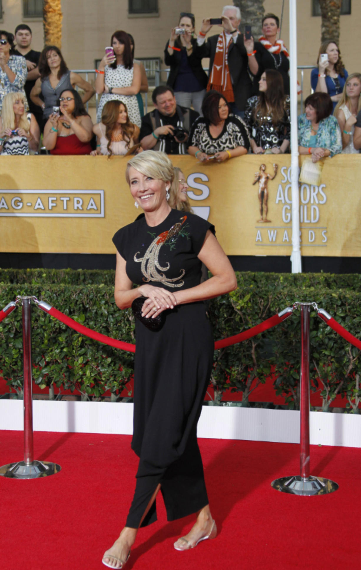 Emma Thompson arrives at the 20th Annual Screen Actors Guild Awards at the Shrine Auditorium in Los Angeles on 2014. (Allen J.