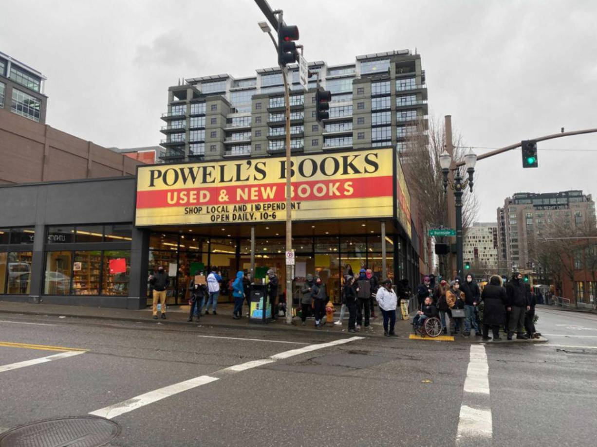 Demonstrators gather at Powell's Books on West Burnside in downtown Portland on Jan. 1 to protest the listing of Andy Ngo's book on the Powell's website.