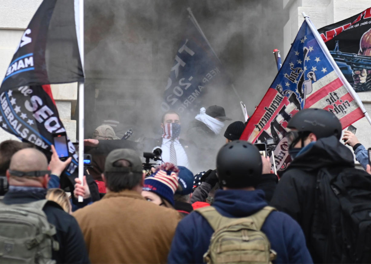 Trump supporters are tear gassed outside the U.S. Capitol in Washington, D.C. on Wednesday, Jan. 6, 2021. Demonstrators breeched security and entered the Capitol as Congress debated the a 2020 presidential election Electoral Vote Certification.