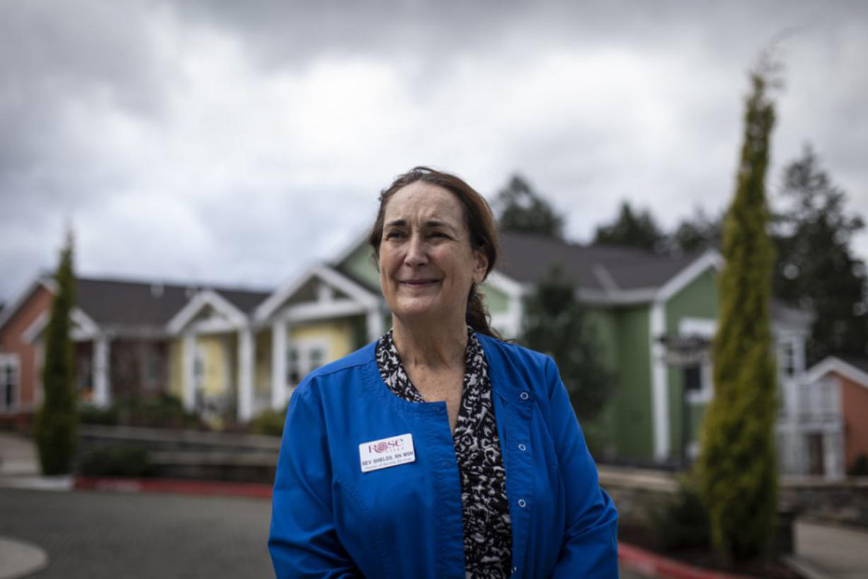 Bev Shields, nursing director at Rose Villa Senior Living in Oak Grove, Oregon oversaw some of her staff as they received the first round of Pfizer COVID-19 vaccines at the facility on December 21, 2020.