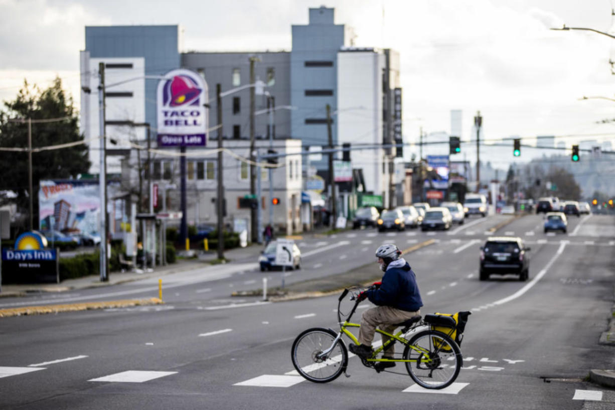 Bikers and pedestrians along Highway 99 in Seattle on Jan. 6, 2021.