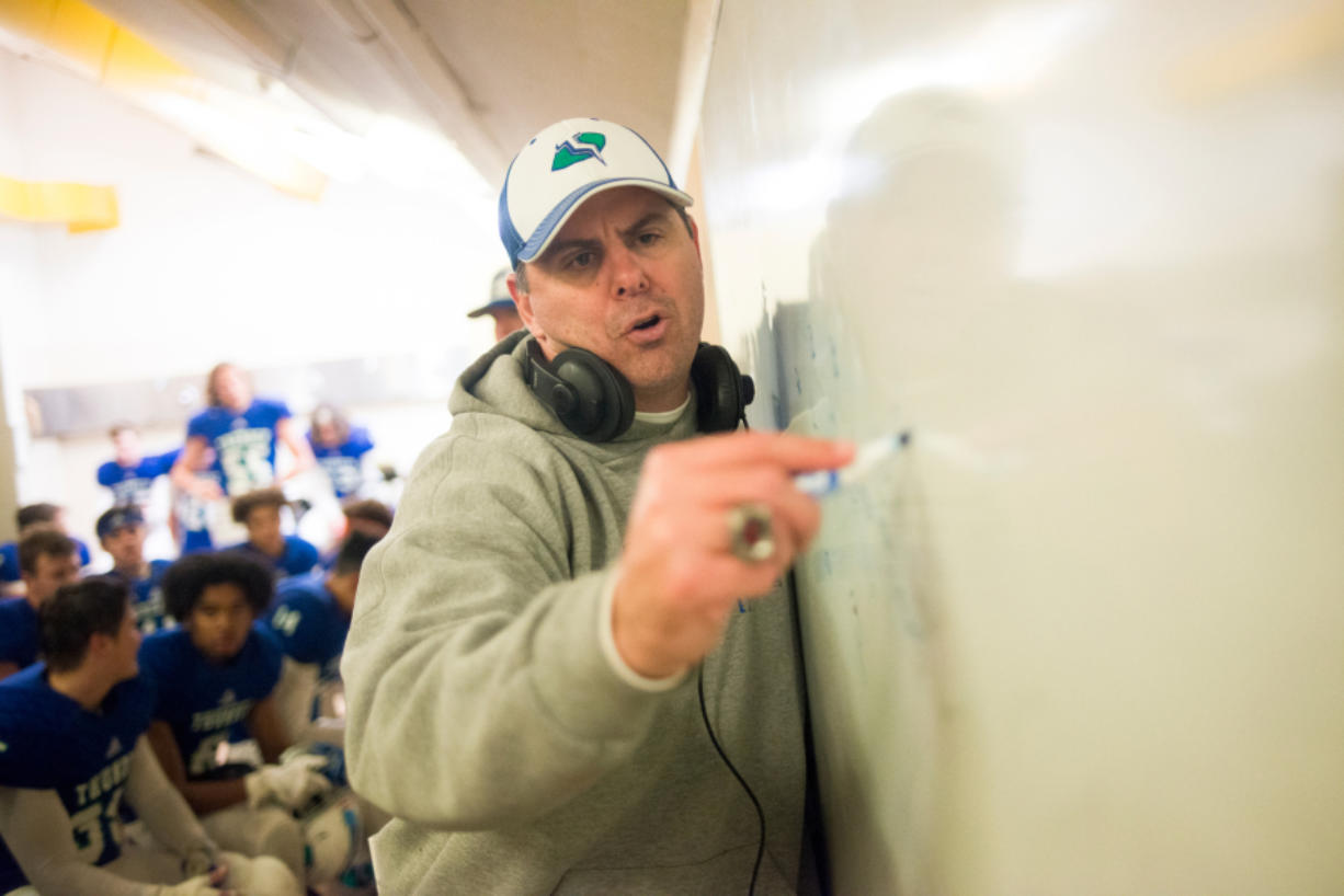 Mountain View head coach Adam Mathieson draws plays for his team during halftime of a game against Squalicum at McKenzie Stadium. As athletic director, Mathieson has been tested in a different way by the uncertainty posed by COVID-19.