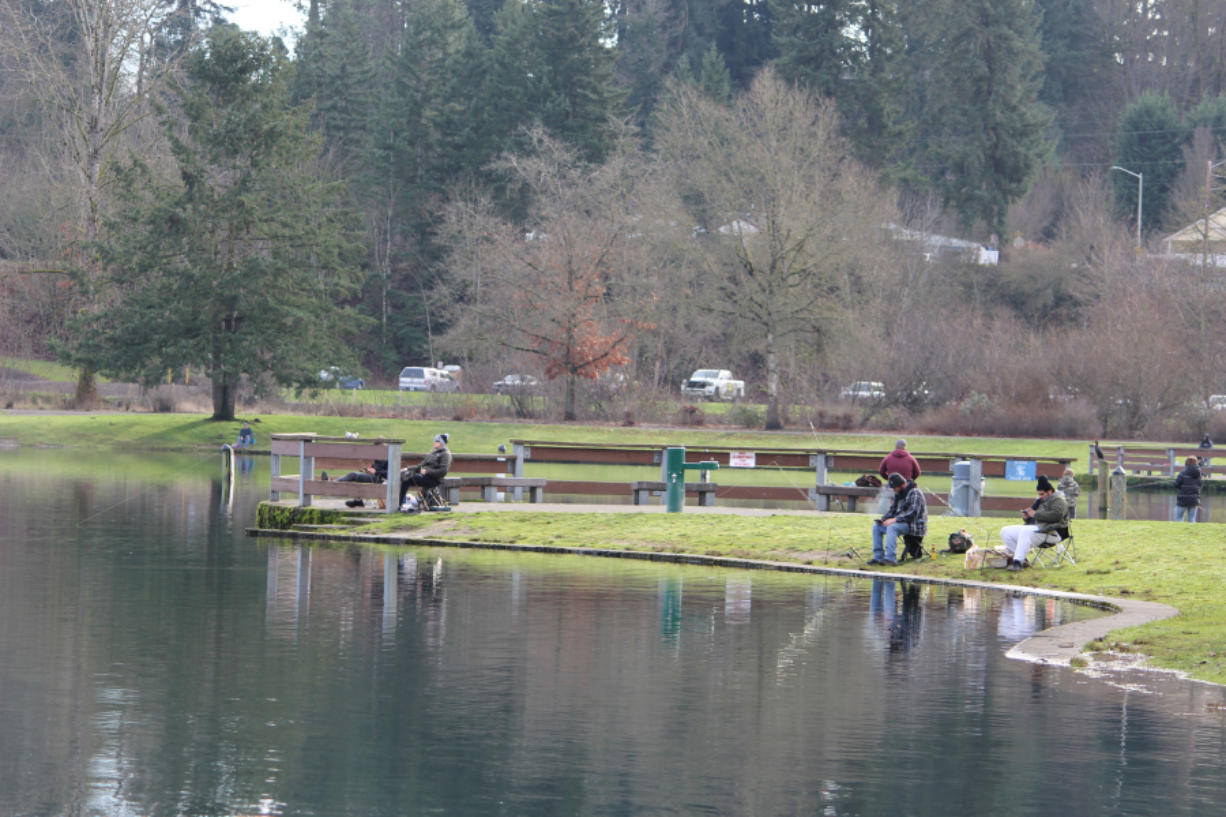 Anglers try their luck for trout at Klineline Pond in Salmon Creek Park in Vancouver recently. With most indoor recreation shut down because of the COVID-19 pandemic, more and more people are turning to fishing, hunting, and other outdoor activities.