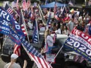 "LOS ANGELES, CA - OCTOBER 31: A large crowd chants ""four more years"" during a Pro Trump rally on Santa America Blvd and Beverly Blvd in Beverly Hills days before the Presidential election. on Saturday, Oct. 31, 2020. The crowd is large and very loud, but peaceful."