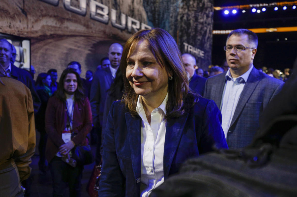 Mary Barra, chairman and CEO of General Motors, is shown at the reveals of the new 2021 Chevrolet Suburban and 2021 Chevrolet Tahoe SUVs at Little Caesars Arena in 2019 in Detroit. Barra said the automaker will bring to market 30 all-electric models globally by the middle of the decade.