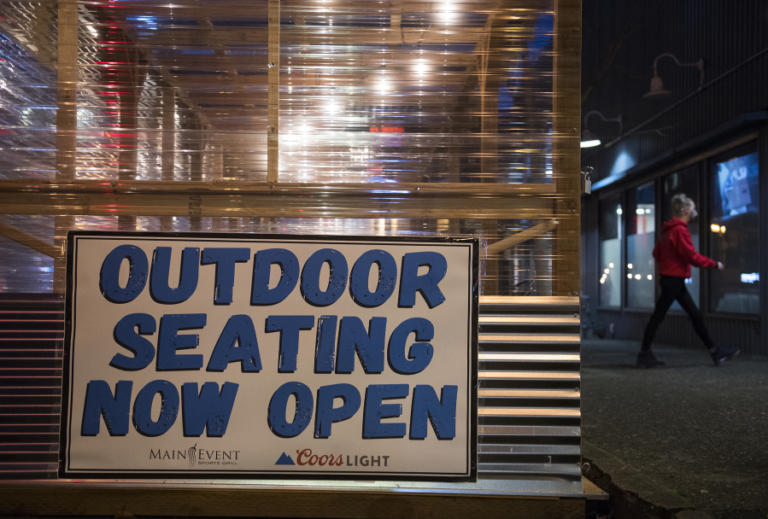A sign informs customers of alternative dining options at the Main Event in downtown Vancouver. Main Event put up the outdoor seating area in late December, and revenue increased from the customers drawn to the restaurant, but it still isn't profitable, said co-owner Jason Fish.