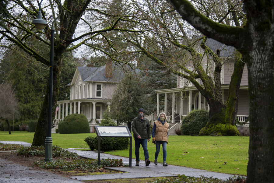John and Trish McDermott of Vancouver walk along Officers Row.