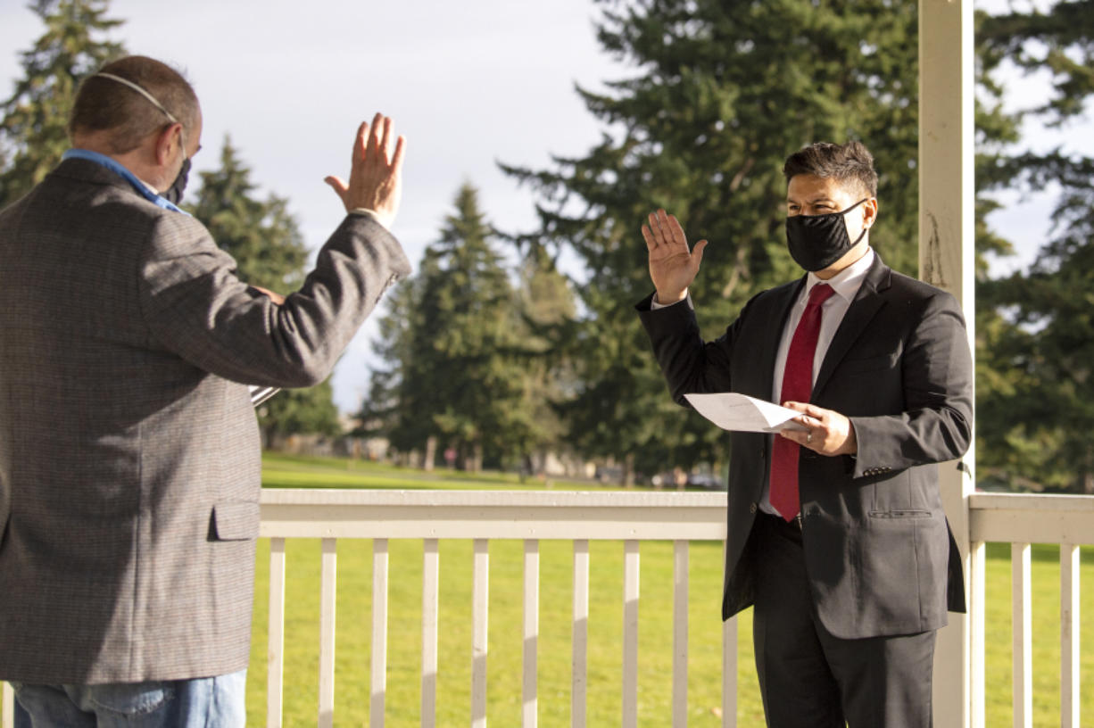 Retiring state Court of Appeals Judge Rich Melnick, left, swears in incoming Judge Bernard Veljacic on Dec. 31 at the bandstand at Fort Vancouver National Historic Site.