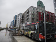 A bus on Route 71 pulls into one of the two new stops at The Waterfront Vancouver on Monday afternoon, January 11, 2021.