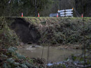 Stormy winter weather caused a small landslide Wednesday about a half-mile southeast of Daybreak Bridge in the 24700 block of Northeast 92nd Avenue in Battle Ground. Clark County Public Works crews planned to close Northeast Manley Road near where it becomes 92nd Avenue.