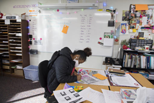 Sophomore Eboni Morris, 15, joins fellow students while working on homework in person at Legacy High School on Tuesday morning.