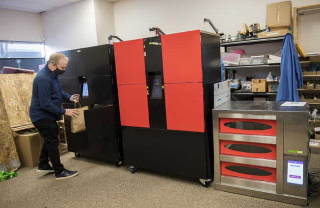 Mike Wallace, co-founder and CEO of Perfect Company, demonstrates a touchless food pickup cabinet at Perfect's downtown Vancouver lab space.