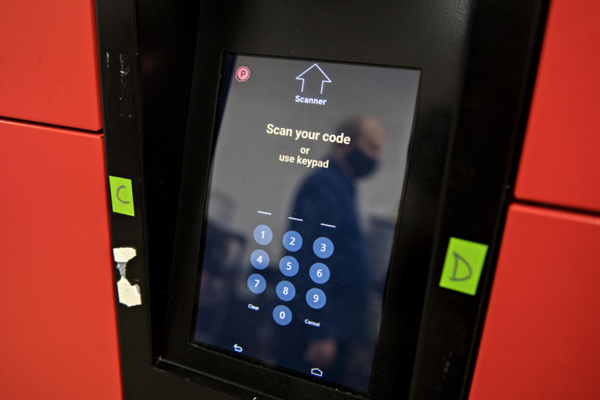 Customers use their smartphones to generate a QR code, which the cabinet scans, to open the door and retrieve their orders.