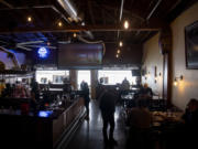 Guests eat indoors on Tuesday at Uptown Barrel Room in Vancouver's Uptown Village.