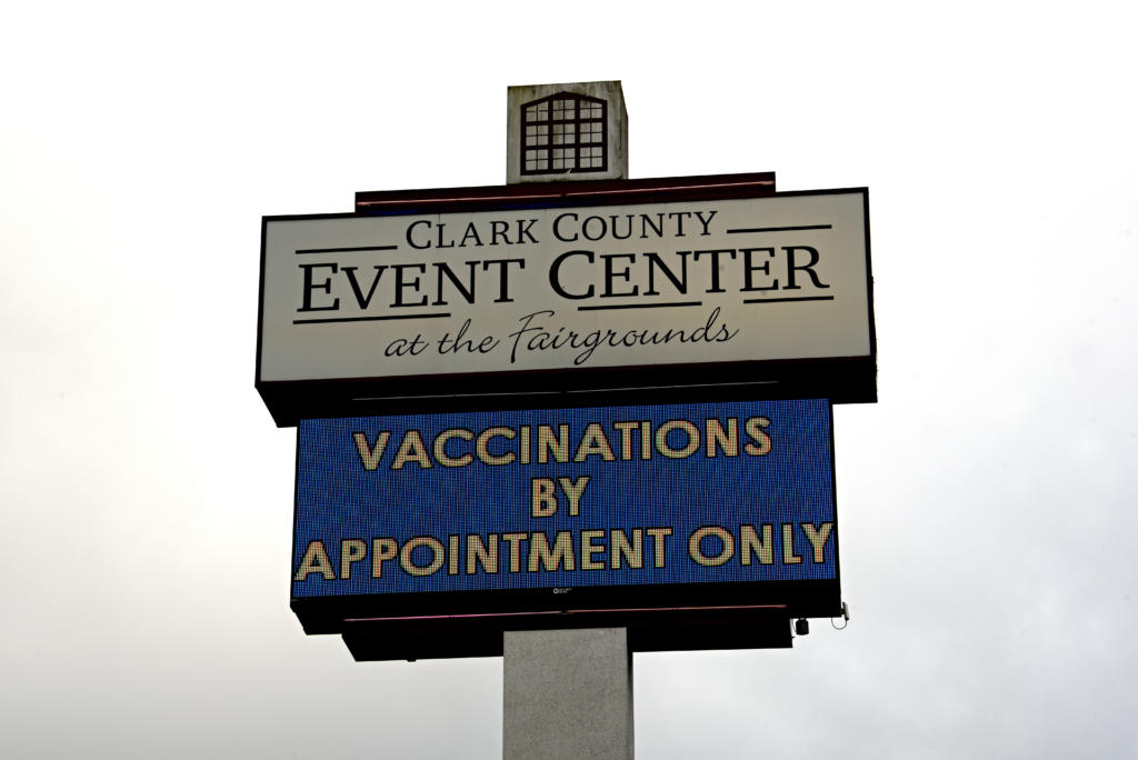 SECONDARY A sign outside Clark County Event Center at the Fairgrounds informs the public that COVID-19 vaccinations are by appointment only, as seen Monday afternoon, Jan. 25, 2021.